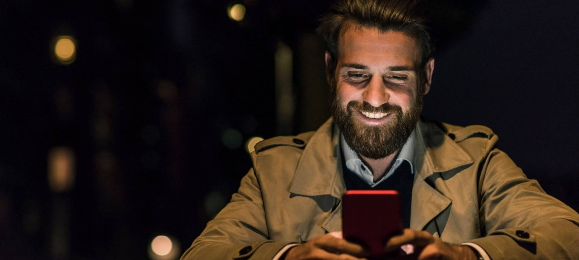 Kelly services Boy smiling at phone